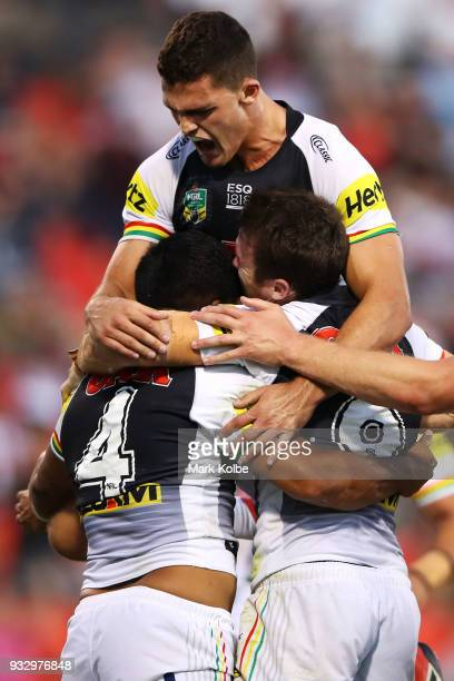 Tyrone Peachey Nathan Cleary and James Maloney of the Panthers celebrate after Tyrone Peachey of the Panthers scored a try during the round two NRL...