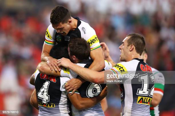 Tyrone Peachey Nathan ClearyJames Maloney and Isaah Yeo of the Panthers celebrate after Tyrone Peachey of the Panthers scored a try during the round...