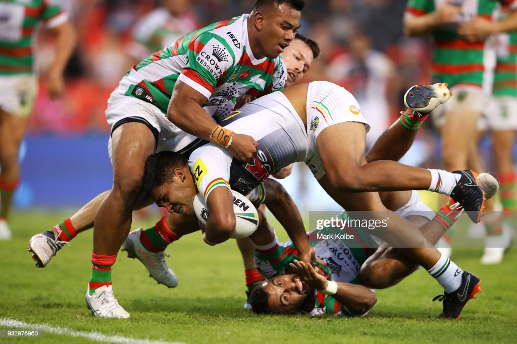 Tyrone Peachey of the Panthers breaking the tackle of Richard Kennar and Alex Johnston of the Rabbitohs on his way to score a try during the round two NRL match between the Penrith Panthers and the South Sydney Rabbitohs at Penrith Stadium on March 17, 2018 in Sydney, Australia.