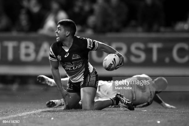 Tyrone Peachey of the Panthers celebrates scoring the match winning try during the round 14 NRL match between the Penrith Panthers and the Canberra...