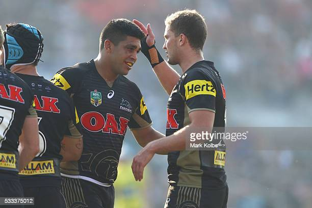 Tyrone Peachey of the Panthers celebrates with his team mate Matt Moylan of the Panthers after scoring a try during the round 11 NRL match between...