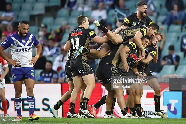 Tyrone Peachey of the Panthers celebrates with his team mates after scoring a try during the NRL Elimination Final match between the Penrith Panthers...