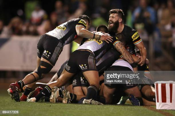 Tyrone Peachey of the Panthers celebrates with his team mates after scoring the match winning try during the round 14 NRL match between the Penrith...