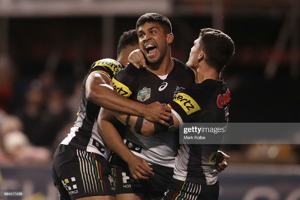Tyrone Peachey (C) of the Panthers celebrates with his team mates Waqa Blake and Nathan Cleary of the Panthers after scoring a try during the round 14 NRL match between the Penrith Panthers and the Canberra Raiders at Carrington Park on June 10, 2017 in Bathurst, Australia.