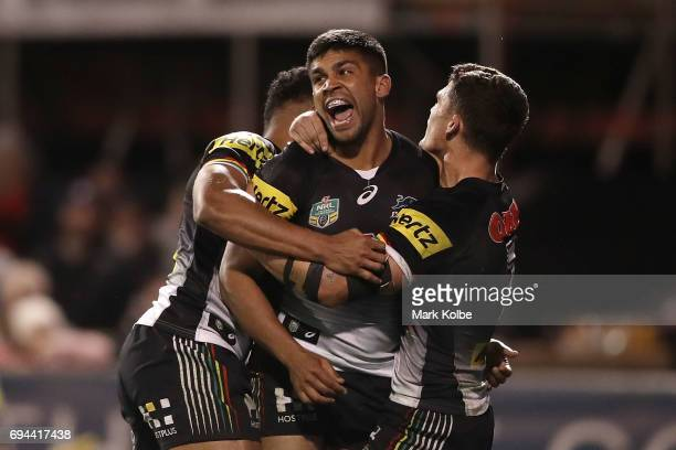 Tyrone Peachey of the Panthers celebrates with his team mates Waqa Blake and Nathan Cleary of the Panthers after scoring a try during the round 14...