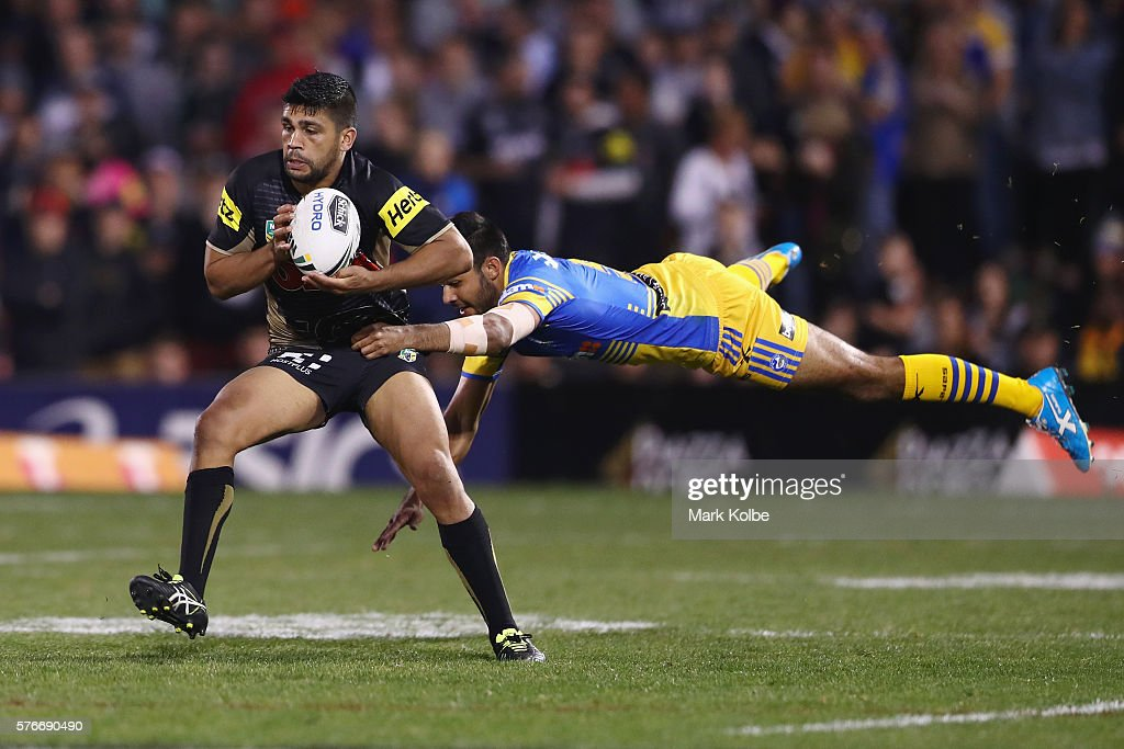 Tyrone Peachey of the Panthers evades the tackle of Bevan French of the Eels during the round 19 NRL match between the Penrith Panthers and the Parramatta Eels at Pepper Stadium on July 17, 2016 in Sydney, Australia.