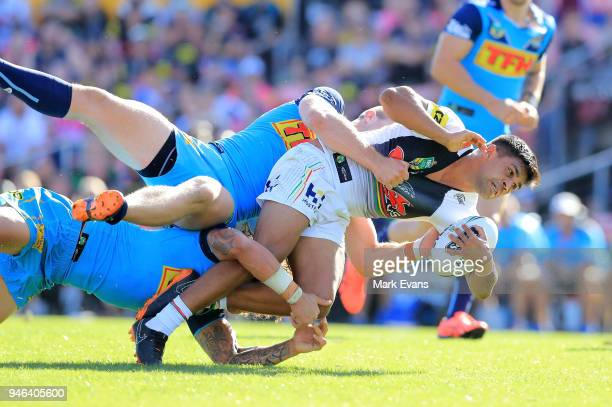 Tyrone Peachey of the Panthers forces his way through the Titans defence during the round six NRL match between the Penrith Panthers and the Gold...