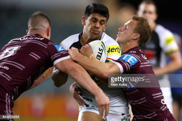 Tyrone Peachey of the Panthers is tackled by Darcy Lussick and Daly CherryEvans of the Sea Eagles during the NRL Elimination Final match between the...