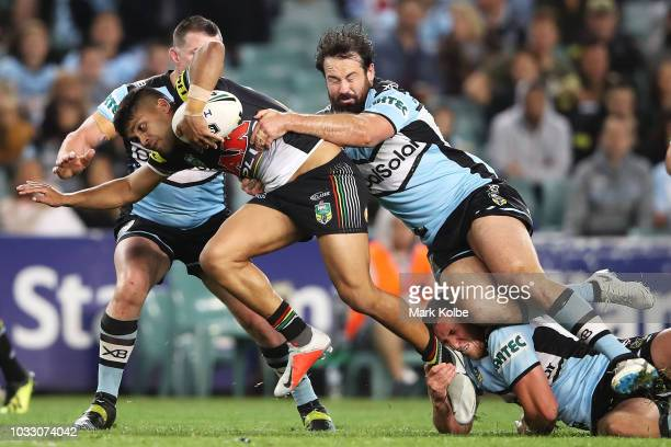 Tyrone Peachey of the Panthers is tackled by Paul Gallen and Aaron Woods of the Sharks during the NRL Semi Final match between the Cronulla Sharks...