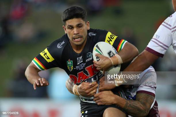PENRITH AUSTRALIA JUNE Tyrone Peachey of the Panthers is tackled during the round 16 NRL match between the Penrith Panthers and the Manly Sea Eagles...