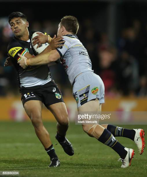 Tyrone Peachey of the Panthers is tackled during the round 23 NRL match between the Penrith Panthers and the North Queensland Cowboys at Pepper...