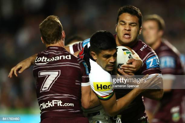 Tyrone Peachey of the Panthers is tackled during the round 26 NRL match between the Manly Sea Eagles and the Penrith Panthers at Lottoland on...