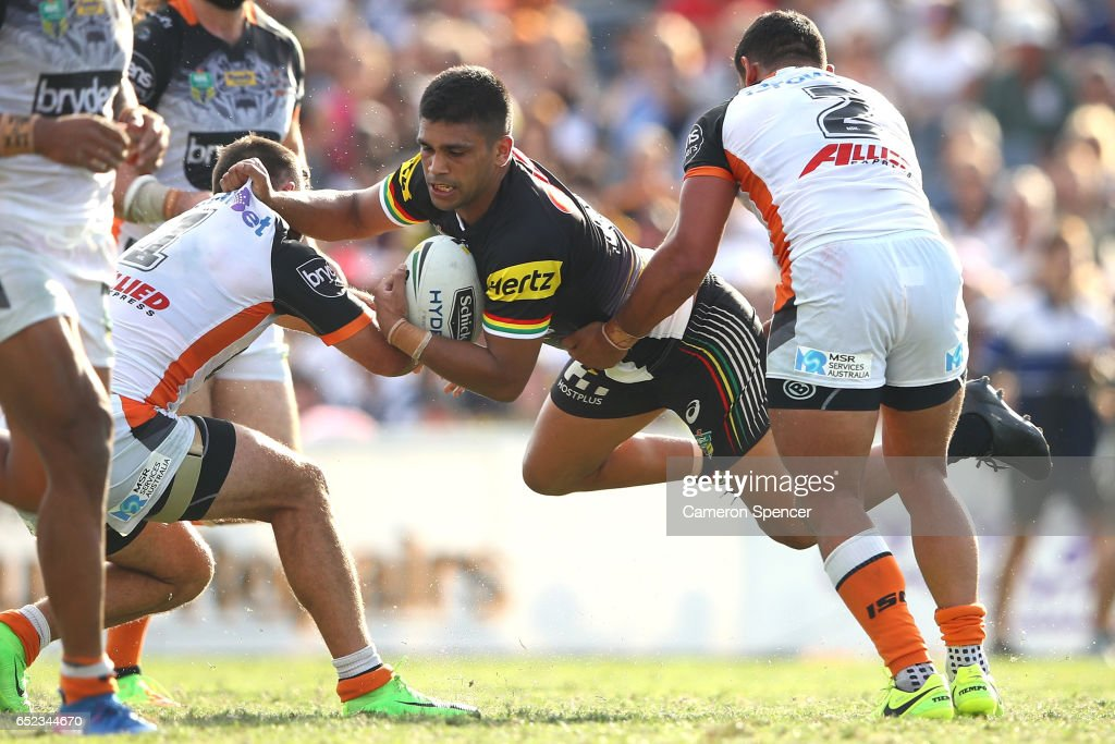 Tyrone Peachey of the Panthers is tackled during the round two NRL match between the Wests Tigers and the Penrith Panthers at Campbelltown Sports Stadium on March 12, 2017 in Sydney, Australia.