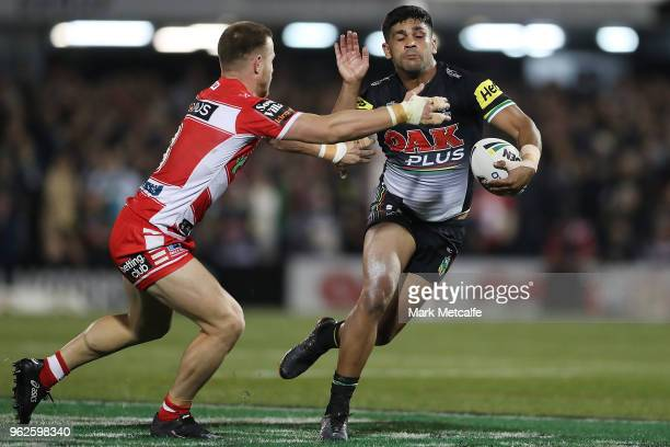 Tyrone Peachey of the Panthers runs at Matt Duffy of the Dragons during the round 12 NRL match between the Penrith Panthers and the St George...