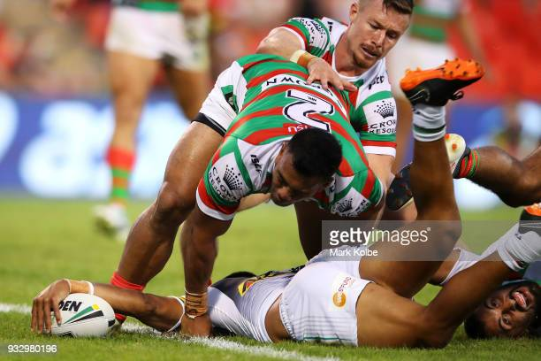 Tyrone Peachey of the Panthers scores a try after breaking the tackle of Richard Kennar and Alex Johnston of the Rabbitohs during the round two NRL...