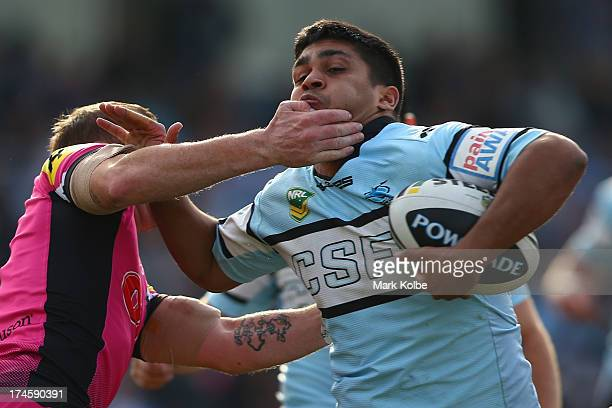 Tyrone Peachey of the Sharks is tackled during the round 20 NRL match between the Cronulla Sharks and the Penrith Panthers at Remondis Stadium on...