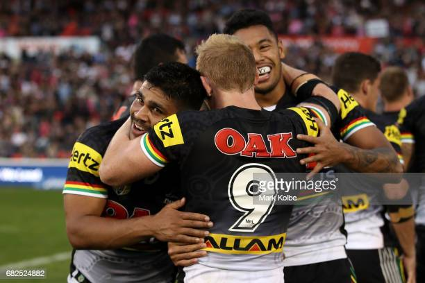 Tyrone Peachey Peter Wallace and Waqa Blake of the Panthers celebrate victory during the round 10 NRL match between the Penrith Panthers and the New...