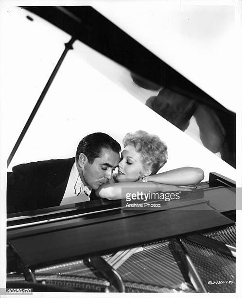 Tyrone Power and Marjorie Oelrichs at piano in a scene from the film 'The Eddy Duchin Story' 1956