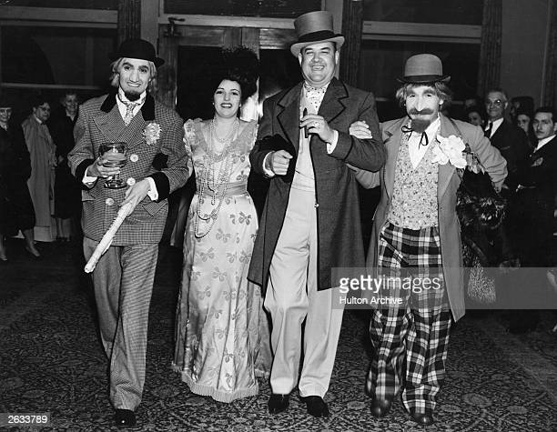 Tyrone Power the American film actor with Julie Carter Don Wilson and Jimmie Star in fancy dress at Edgar Bergen's party held at the Beverly Hills...
