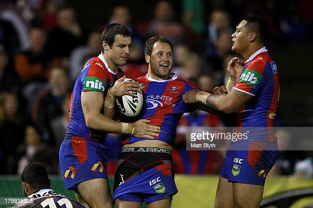 Tyrone Roberts of the Knights celebrates scoring a try during the round 22 NRL match between the Cronulla Sharks and the Newcastle Knights at...
