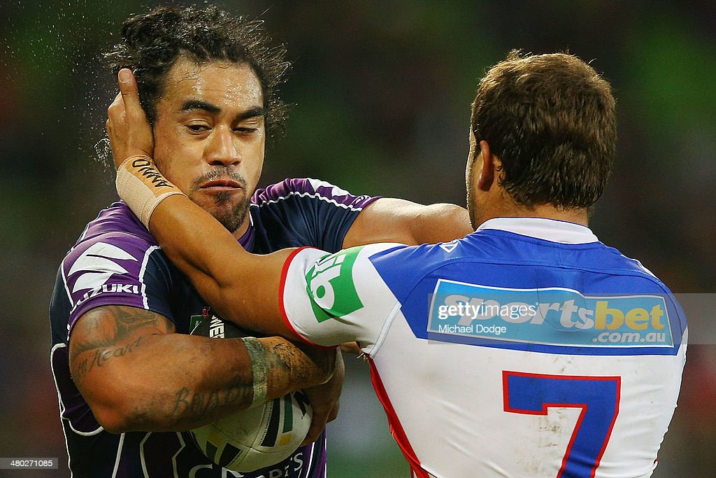 Tyrone Roberts of the Knights tackles Mahe Fonua of the Storm during the round three NRL match between the Melbourne Storm and the Newcastle Knights at AAMI Park on March 24, 2014 in Melbourne, Australia.