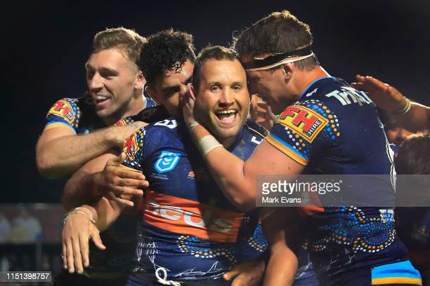Tyrone Roberts of the Titans celebrates a try with team mates during the round 11 NRL match between the Manly Sea Eagles and the Gold Coast Titans at...