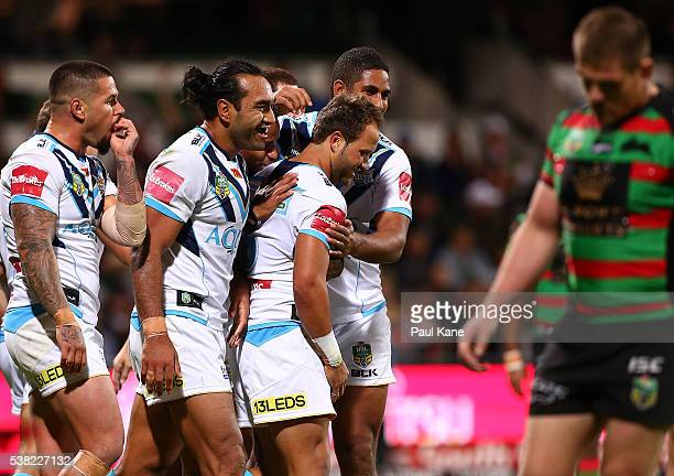 Tyrone Roberts of the Titans is congratulated by team mates after crossing for a try during the round 13 NRL match between the South Sydney Rabbitohs...
