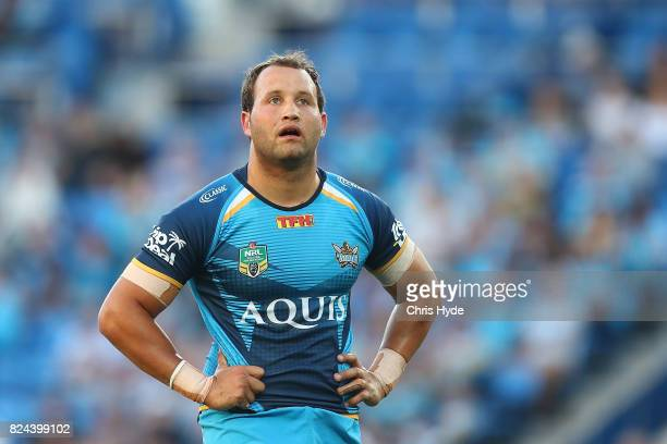Tyrone Roberts of the Titans looks on during the round 21 NRL match between the Gold Coast Titans and the Wests Tigers at Cbus Super Stadium on July...