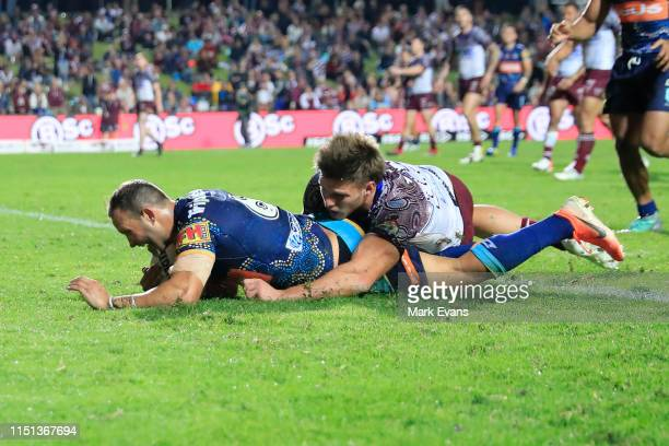 Tyrone Roberts of the Titans scores try during the round 11 NRL match between the Manly Sea Eagles and the Gold Coast Titans at Lottoland on May 24,...