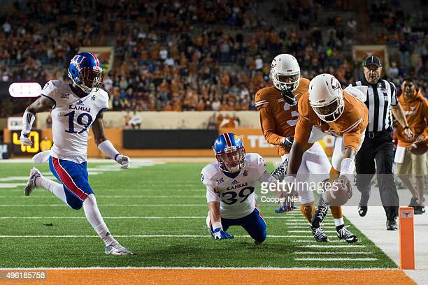 Tyrone Swoopes of the Texas Longhorns recovers a fumble 10 yards for a touchdown against the Kansas Jayhawks during the 4th quarter on November 7...