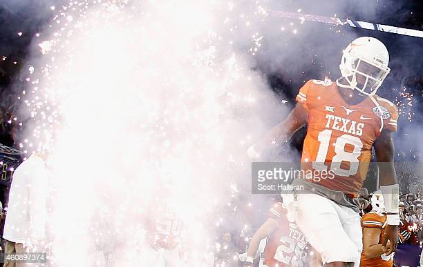 Tyrone Swoopes of the Texas Longhorns runs with his team onto the field at the start of their game against the Arkansas Razorbacks at the AdvoCare...