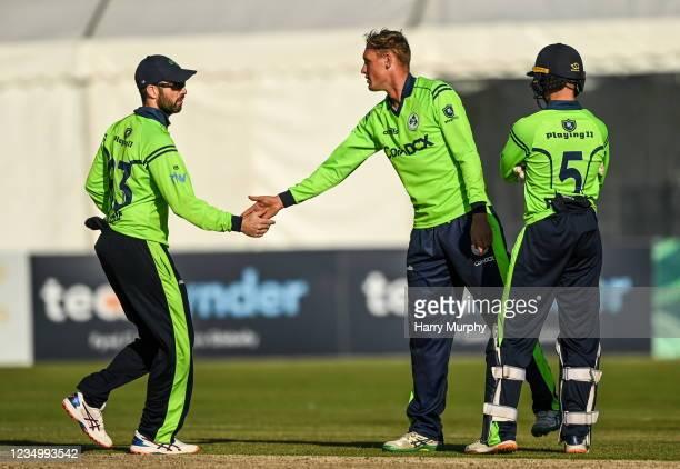 Tyrone , United Kingdom - 1 September 2021; Ben White of Ireland celebrates bowling out Milton Shumba of Zimbabwe with Andrew Balbirnie, left, and...