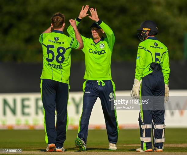 Tyrone , United Kingdom - 1 September 2021; Ireland players, from left, Shane Getkate, Ben White and Neil Rock celebrate the wicket of Craig Ervine...