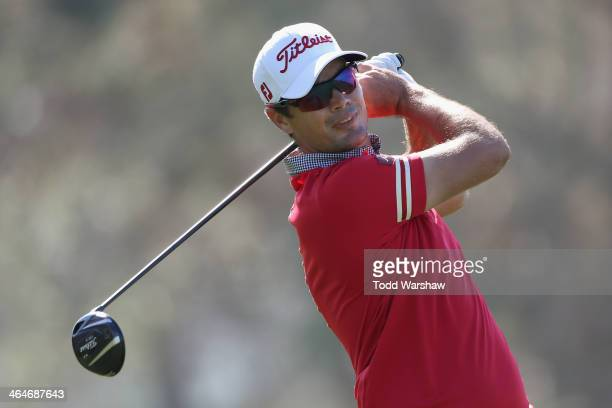Tyrone Van Aswegen hits a tee shot on the 15th hole during the first round of the Farmers Insurance Open on Torrey Pines North on January 23 2014 in...