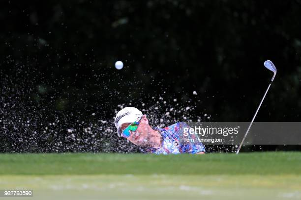 Tyrone Van Aswegen of South Africa plays a shot from a bunker on the seventh hole during round three of the Fort Worth Invitational at Colonial...