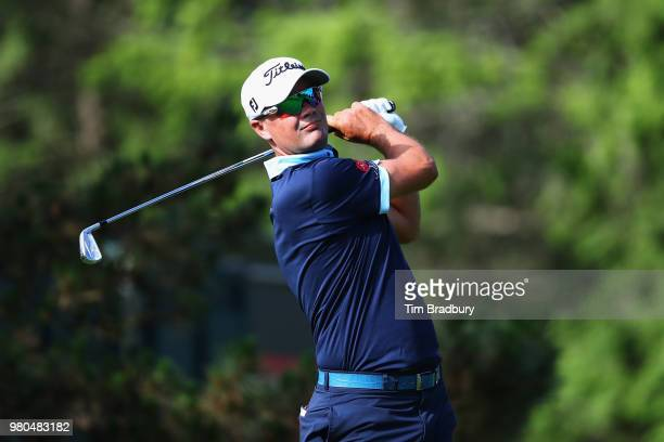Tyrone Van Aswegen of South Africa plays his shot from the fifth tee during the first round of the Travelers Championship at TPC River Highlands on...