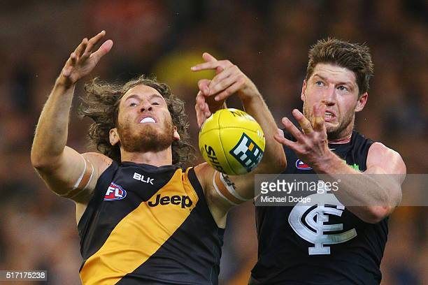Tyrone Vickery of the Tigers and Sam Rowe of the Blues compete for the ball during the round one AFL match between the Richmond Tigers and the...
