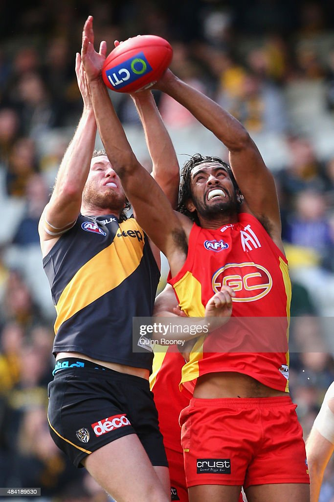 Tyrone Vickery of the Tigers and Tom Nicholls of the Suns compete for a mark during the round 20 AFL match between the Richmond Tigers and the Gold Coast Suns at Melbourne Cricket Ground on August 16, 2015 in Melbourne, Australia.