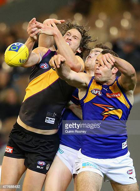 Tyrone Vickery of the Tigers competes for a mark against Jeremy McGovern and Shannon Hurn of the Eagles during the round 12 AFL match between the...