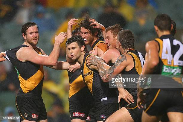 Tyrone Vickery of the Tigers is congratulated by team mates after kicking a goal during the round 18 AFL match between the West Coast Eagles and the...