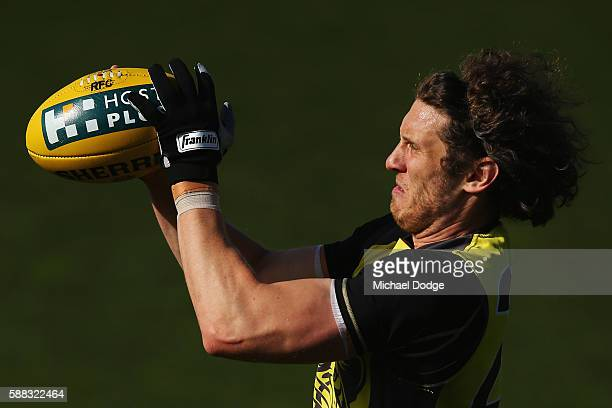Tyrone Vickery of the Tigers marks the ball during a Richmond Tigers AFL training session at Punt Road Oval on August 11 2016 in Melbourne Australia