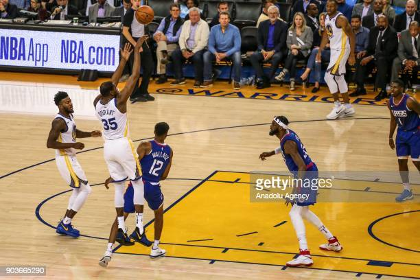 Tyrone Wallace of LA Clippers in action against Kevin Durant of Golden State Warriors during the NBA basketball game between LA Clippers and Golden...