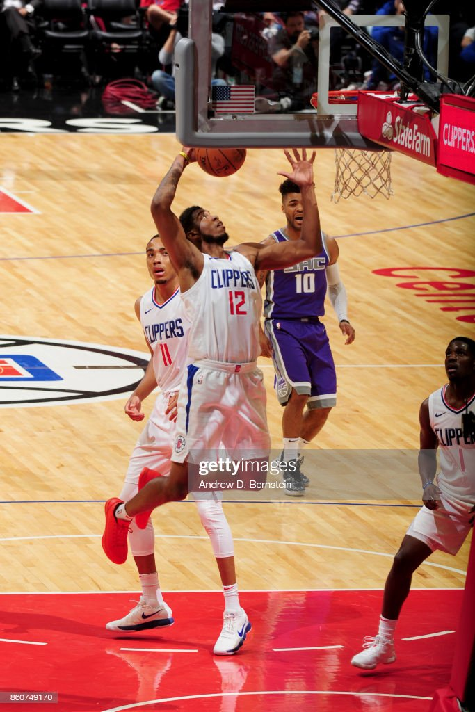Tyrone Wallace #12 of the LA Clippers goes to the basket against the Sacramento Kings on October 12, 2017 at STAPLES Center in Los Angeles, California.