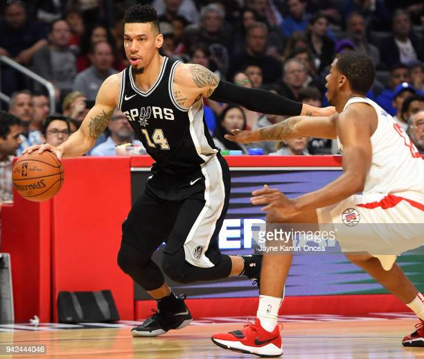Tyrone Wallace of the Los Angeles Clippers guards Danny Green of the San Antonio Spurs in the game at Staples Center on April 3 2018 in Los Angeles...