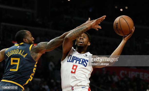Tyrone Wallace of the Los Angeles Clippers plays against Andre Iguodala of the Golden State Warriors on November 12 2018 at STAPLES Center in Los...