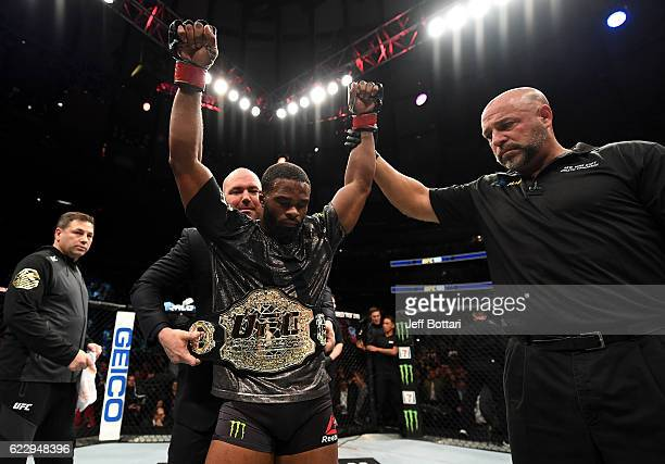 Tyrone Wodley of the United States reacts against Stephen Thompson of the United States in their welterweight championship bout during the UFC 205...