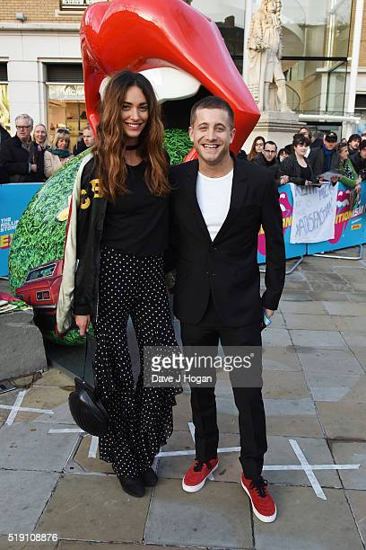 Tyrone Wood and a guest arrive for the private view of 'The Rolling Stones Exhibitionism' at Saatchi Gallery on April 4 2016 in London England