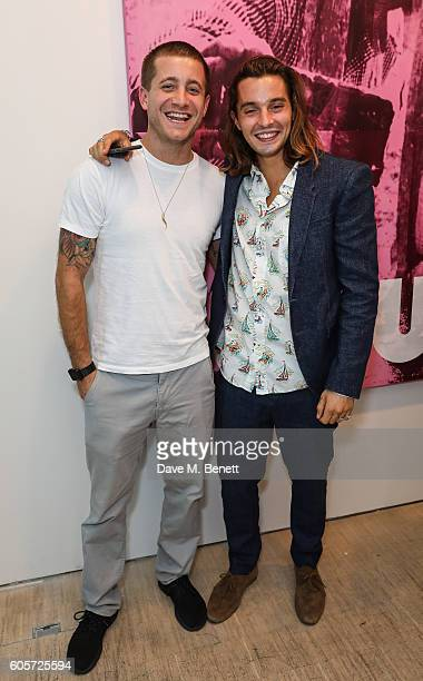 Tyrone Wood and Oscar Tuttiett attend a private view of 'Stutter' a new exhibition by Kingsley Ifill at The Cob Gallery on September 14 2016 in...