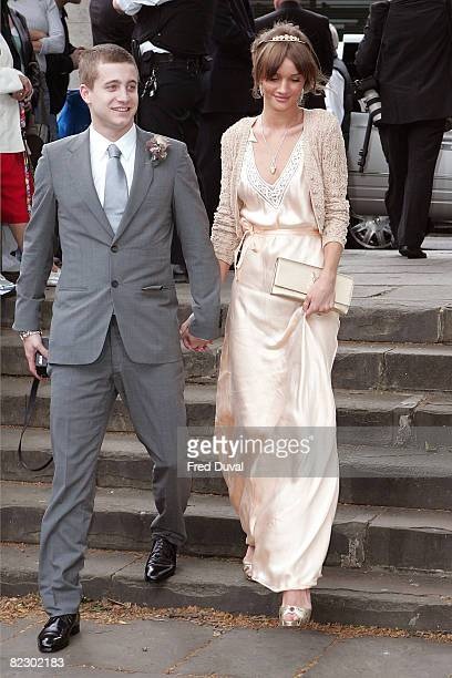 Tyrone Wood and Rosie HuntingtonWhiteley attend Leah Wood and Jack Macdonald's wedding at Southwark Cathedral on June 21 2008 in London England