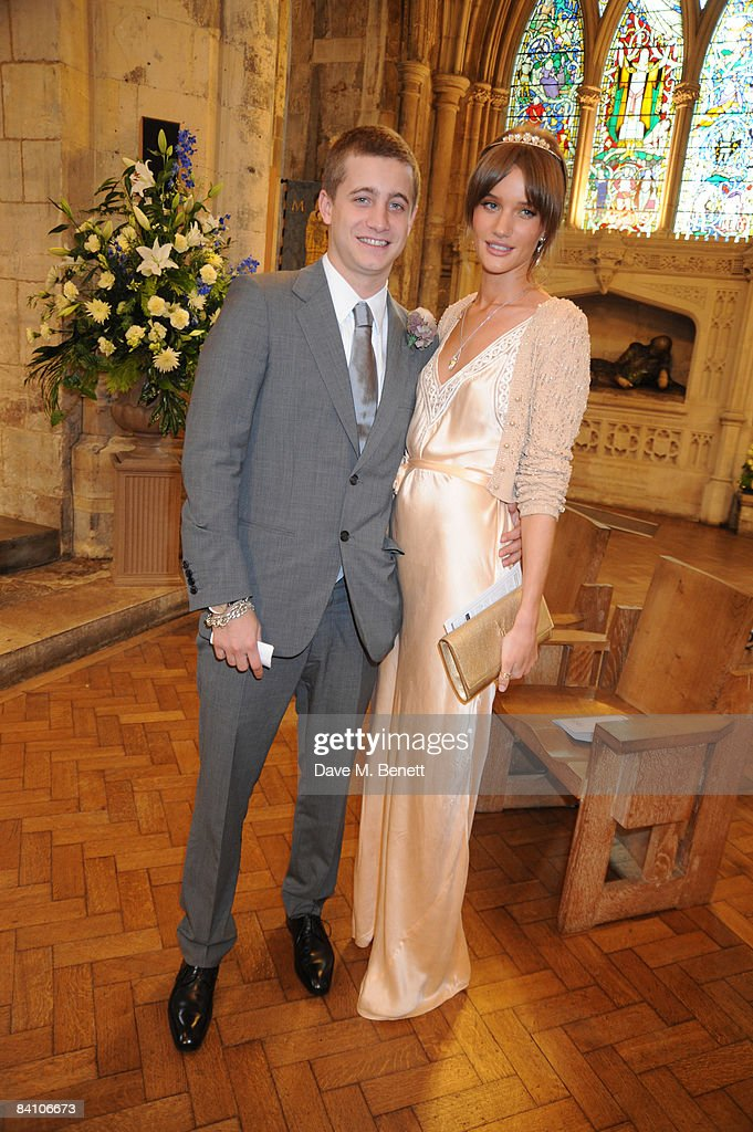 Tyrone Wood and Rosie Huntington-Whiteley attend the wedding of Leah Wood and Jack MacDonald at Southwark Cathedral on June 21, 2008 in London, England.